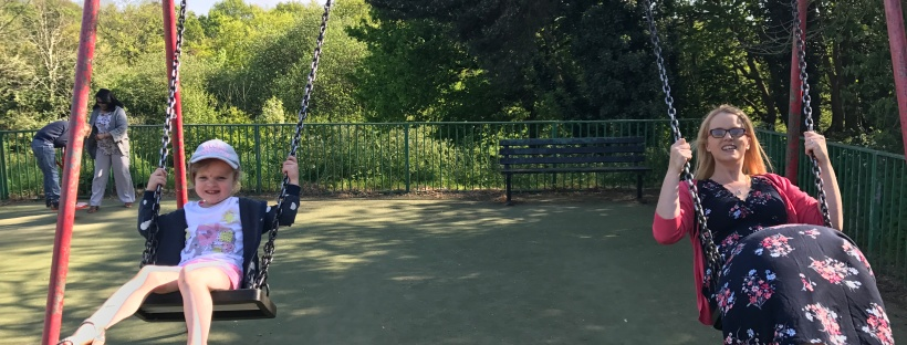 mommy and daughter on swings together