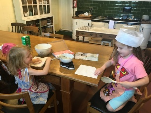 two girls baking together