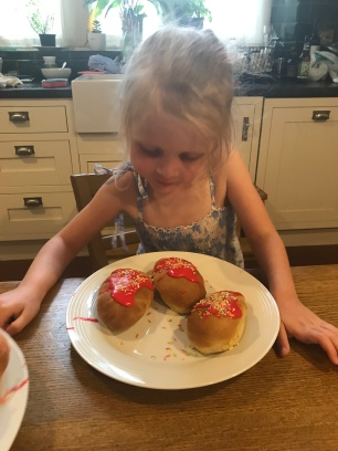 child looking at cakes she has made