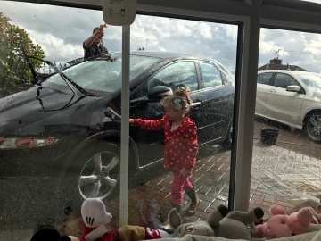 girl helping daddy clean the cars