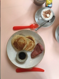 Children's pancakes with bacon and maple syrup