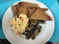 scrambled eggs on toast with mushrooms
