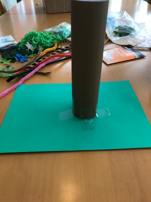 use a brown piece of paper to make into a tree trunk