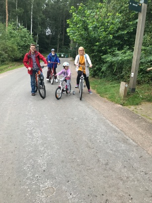family riding bikes at center parcs