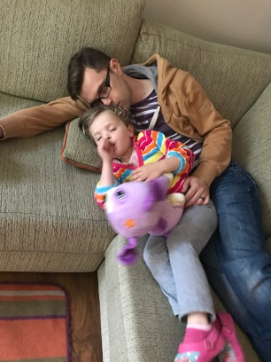 daddy and child asleep on sofa