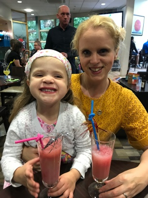 mom and daughter sharing fruit cocktails