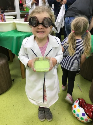child in lab coat and goggles with slime
